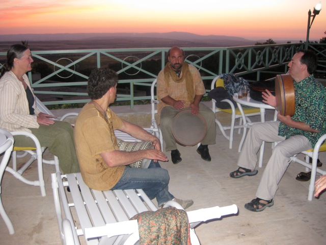 Dror, Jamie, and Andy playing drums during the Moroccan sunset