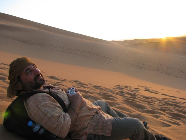 Dror watching the sunrise over the Sahara