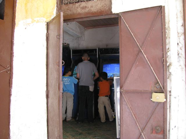 Some kids playing video games in Fes